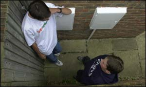 Teenage boys talking in alleyway