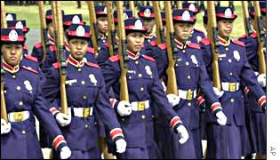 Female police officers march during the 12th anniversary of the Philippine national police