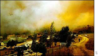 Flames, hot smoke and debris circle the small town of Omeo in Australia's Victoria state