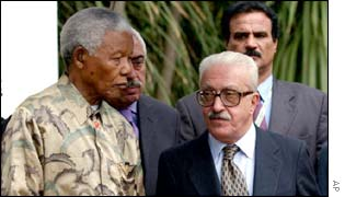 Mandela with Iraqi Deputy Prime Minister Tariq Aziz, right, in September 2002