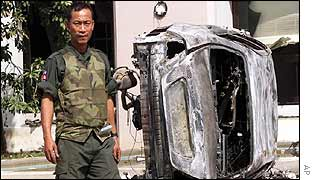 Cambodian official in body armour after rioting