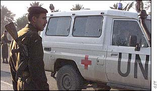 Iraqi soldier by a UN vehicle in Baghdad