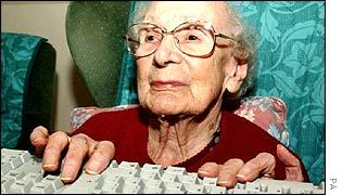 Old woman using a keyboard