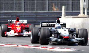 David Coulthard's McLaren ahead of Michael Schumacher's Ferrari in Monaco