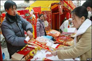Woman buys New Year decorations in Beijing