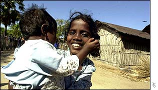 Tamil girl Madialan Rosa smiles after meeting Singhalese members of a peace delegation for the  first time