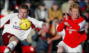 Crewe goalscorer Steve Jones (right) takes evasive action as Northampton's Paul Reid clears his lines