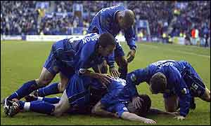 Leicester players celebrate Paul Dickov's winner