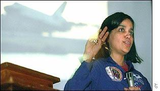 Astronaut Kalpana Chawla in front of shuttle image