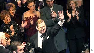 Czech President Vaclav Havel bids farewell at the end of a gala evening in Prague's National Theatre