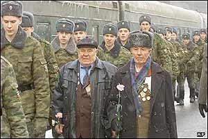 Two war veterans (centre) who fought in Stalingrad prepare to board a train to Volgograd,