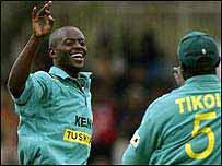 Martin Suji takes a wicket
