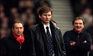 Roeder is watched by a happy Liverpool backroom staff