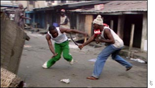 Two Nigerian men fighting in the street
