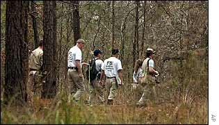 FBI personnel search Texas woods for wreckage of the space shuttle Columbia