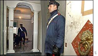 Italian Carabinieri paramilitary police officers inspecting the building