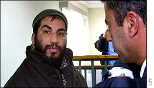 Palestinian Nabil Okal talks to a lawyer at an Israeli military court