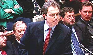 Robin Cook watches Tony Blair at question time