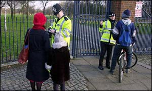 Police question passers-by in Victoria Park