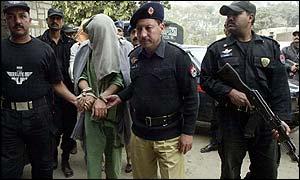 Pakistani security staff arrest a suspect
