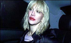 Courtney Love leaving Heathrow police station
