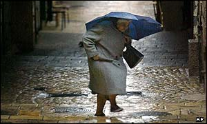A woman makes her way through Jerusalem's Old City in the rain
