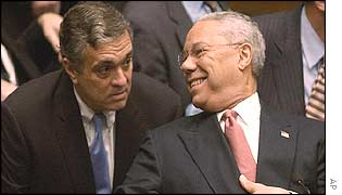 George Tenet (left) and Colin Powell after Powell's address