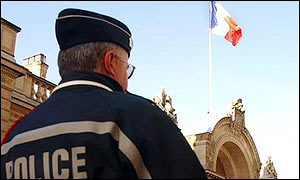 A French policeman stands guard at the Elysee Palace