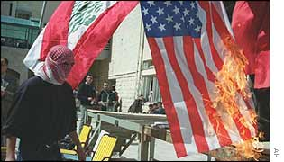 Palestinian burns US flag