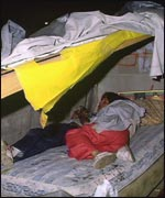 Homeless person asleep in hostel