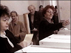 women at ballot boxes