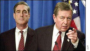 FBI Director Robert Mueller (l) with US Attorney General John Ashcroft at a press conference