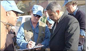 UN weapons inspectors speak to members of the Iraqi National Monitoring Directorate