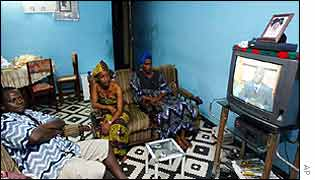 Ivorians watch the president's speech