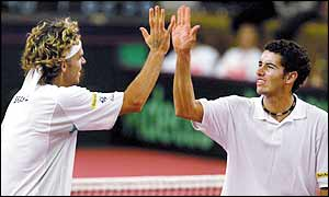 Gustavo Kuerten (left) and Andre Sa celebrate winning the doubles for Brazil against Sweden