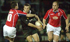 Pontypool's Nicky Lloyd is caught by Llanelli fly-half Gareth Bowen