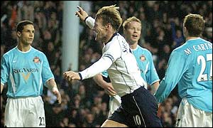 Teddy Sheringham celebrates reaching 300 league goals