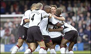 Jon Harley celebrates his goal with the Fulham players