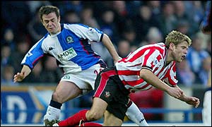 Blackburn's David Thompson and James Beattie of Southampton challenge