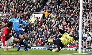 Ruud van Nistelrooy gives Manchester United the lead in the derby against Manchester City
