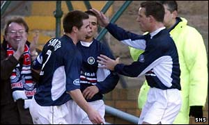 Dundee scorer Nacho Novo  is congratulated on his equaliser