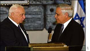 Israeli Prime Minister Ariel Sharon, left, shakes hands with Israeli President Moshe Katsav