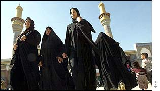 Iraqi women visit the al-Kazimiyeh holy shrine in Baghdad on 10 February