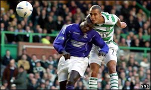 Celtic's Henrik Larsson sustains a broken jaw in a clash with Gustave Bahoken