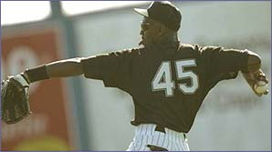Michael Jordan pitches a ball for the Chicago White Sox in practice