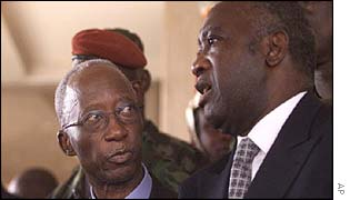Ivory Coast President Laurent Gbagbo (right) talks to Prime Minister Seydou Diarra