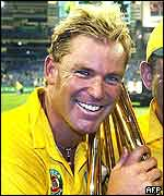 Shane Warne holds the World Cup in 1999