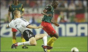 Raymond Kalla is challenged in the World Cup against Germany