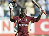 Brian Lara takes the applause after his century at Newlands