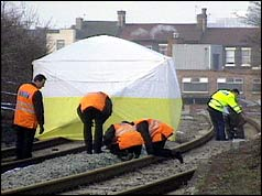 The investigation underway at the scene of the murder